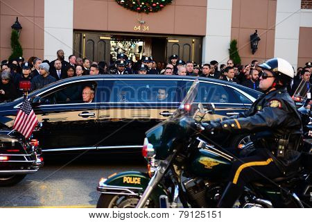 Motor police procession past limosine