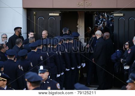 NYPD officers file into church