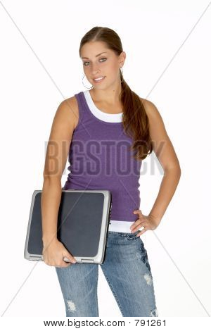 Young Woman in Purple Tank Top with Laptop Under Arm
