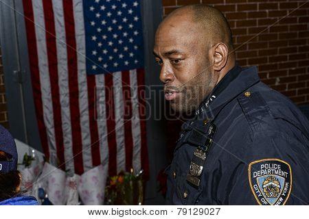 NYPD officer at memorial