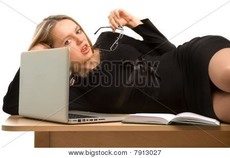 Young Secretary Lying On The Table