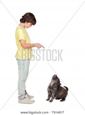 Child Taught To Obey His Puppy