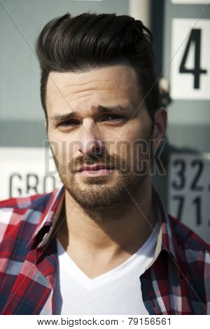 Hansome Man In Striped Shirt And T Shirt With Beard And Funky Haircut