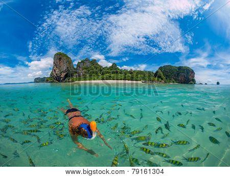 Woman snorkling in Poda Beach in Krabi Thailand