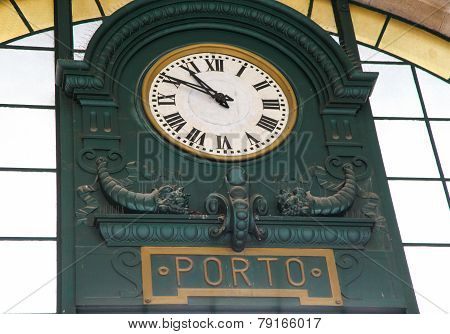 Old station clock in the famous Sao Bento Railway Station at the Almeida Garret Square in Porto Portugal. poster