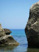 rocks in crystal clear waters poster