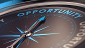 Compass with needle pointing the word opportunity concept image to illustrate business opportunities and strategy. poster
