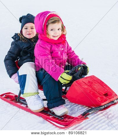 Little Girls On Toboggan