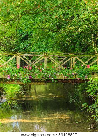 Old Small Bridge Over River In Green Garden.