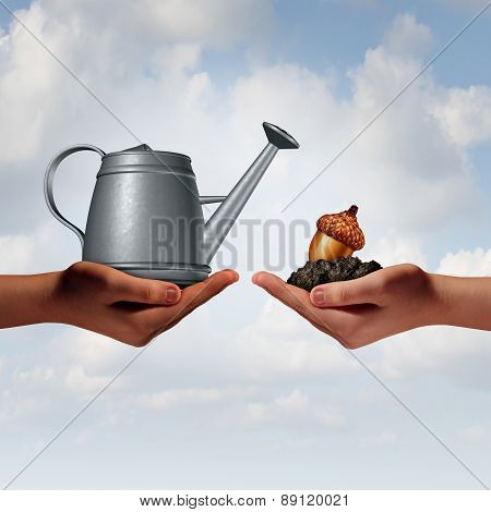Watering can investing business concept as a two diverse human hands holding a water pot and an acorn seed in fertile soil as a financial metaphor for economic development or environmental collaboration and hope for the future. poster