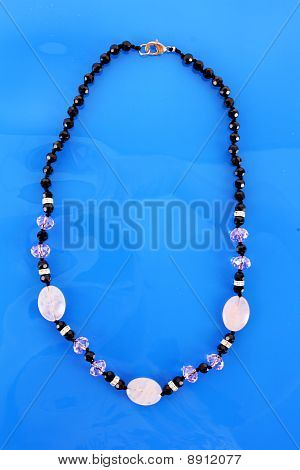 Beads On Blue Background