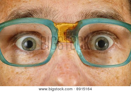 Eyes Of Surprised Person In Old Spectacles