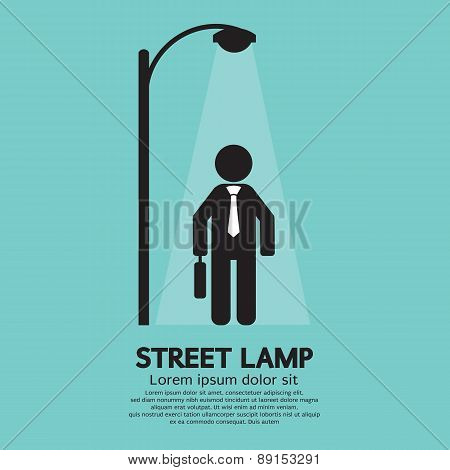 Businessman Walking Under Street Lamp.