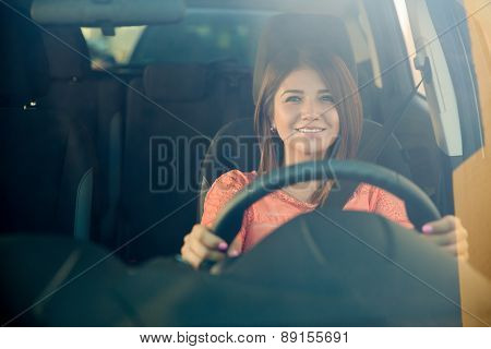 Happy Girl Driving Her Car