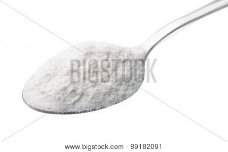 Spoon of baking soda isolated on white