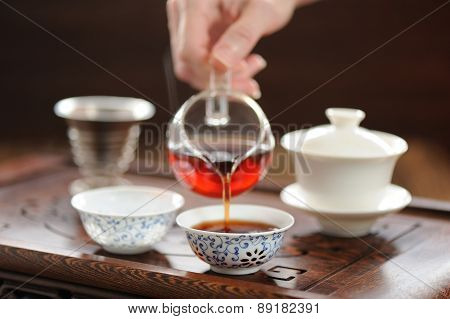 China Tea Ceremony With Puerh Tea Brewing In Haiwan