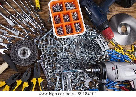 Assorted work tools on wood background poster