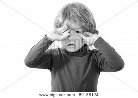 tired child rubbing his eyes isolated on white background