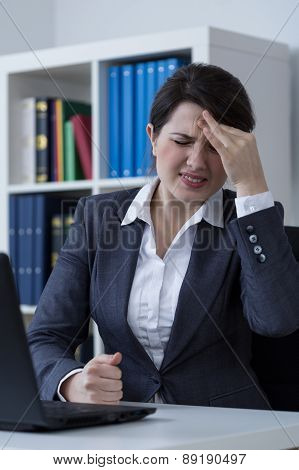 Female office worker having migraine at work poster