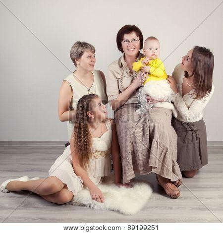 Three generations of women, photo by studio, indoor