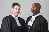 caucasion woman and black man wearing canadian lawyer toga poster