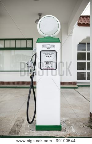 Retro gas pump in front of old gas station, blank logos to fill in yourself