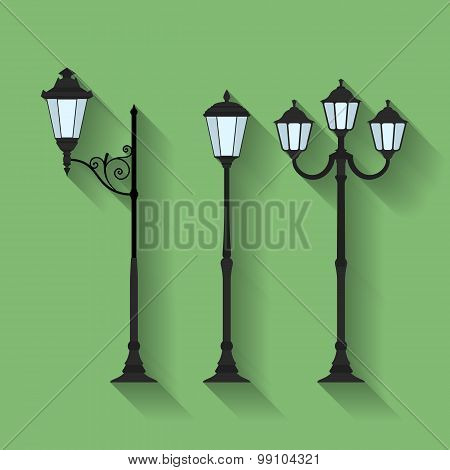 Icon set of three streetlights or lanterns. Flat style