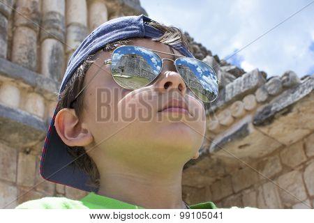 Young Traveler Admires Maya Culture