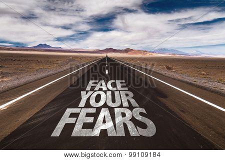 Face Your Fears written on desert road