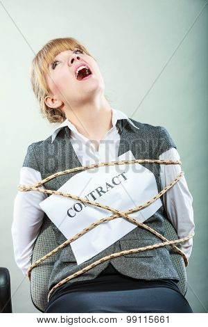 Afraid businesswoman bound by contract terms and conditions. Screaming scared woman tied to chair become slave. Business and law concept. poster