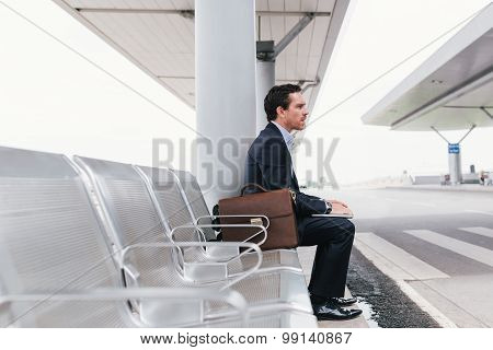 Businessman At The Bus Stop
