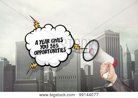 A year gives you 365 opportunities text on speech bubble and businessman hand holding megaphone