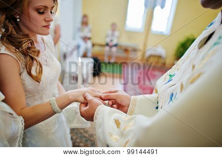 Clergyman Wear Wedding Ring On Hand Of Bride