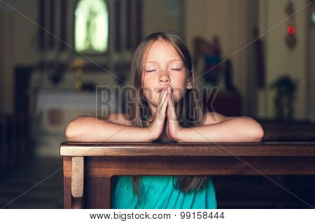 Child praying in church