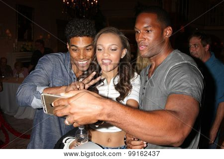 LOS ANGELES - AUG 14:  Rome Flynn, Reign Edwards, Lawrence Saint-Victor_ at the Bold and Beautiful Fan Event Friday at the CBS Television City on August 14, 2015 in Los Angeles, CA