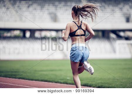 Fitness woman on stadium