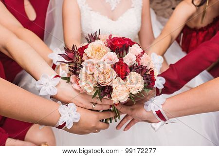 Close-up of a bride and her bridesmaids holding bouquet.
