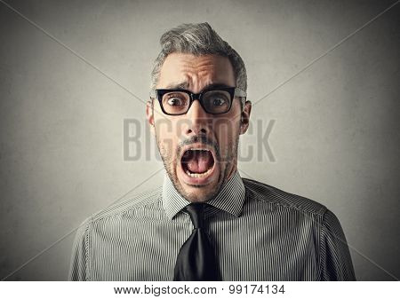 Shocked spellbound businessman