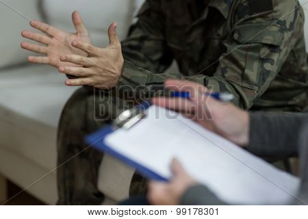 Soldier Sitting On The Sofa