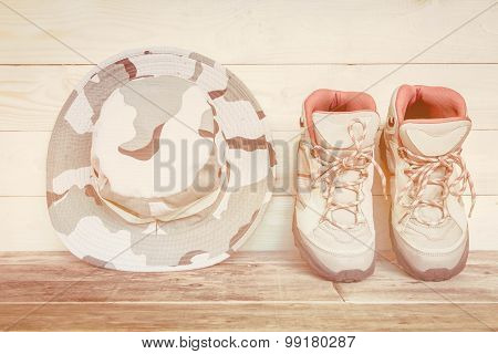 Pair Of Work Boots On Wooden Background.