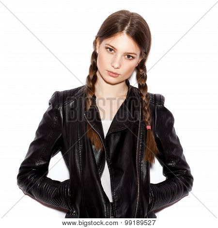 Woman with pigtails in black leather jacket. White background not isolated poster