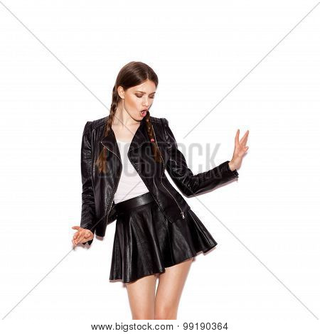 Girl With Pigtails In Black Leather Jacket Dancing
