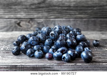 Blueberry  Lie On Wooden Background. Rustic Cozy Background With Healthy Food. Fresh-gathered Berry