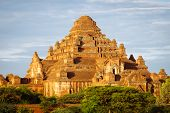 Scenic sunset view of ancient temple Dhammayangyi in Bagan Myanmar poster