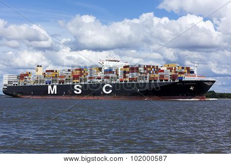 Stade, Germany - September 10, 2015: Container ship MSC Lauren on the Elbe river heading to Hamburg. The ship loads 12.400 TEU, is operated by Mediterranean Shipping Company seated at Geneva.