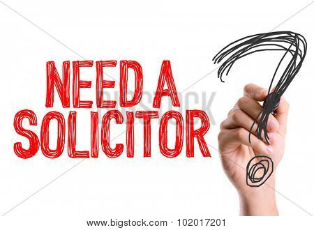 Hand with marker writing: Need a Solicitor?