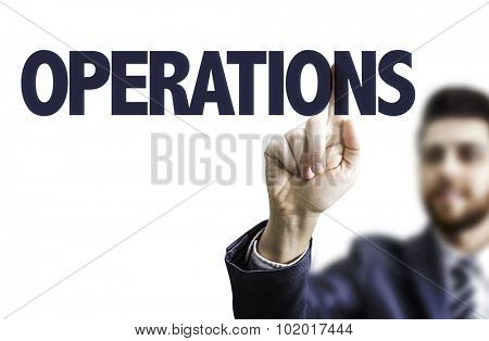 Business man pointing the text: Operations