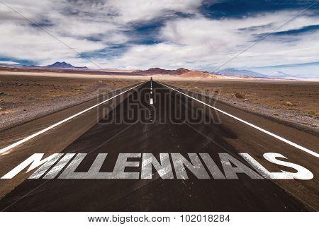 Millennials written on desert road