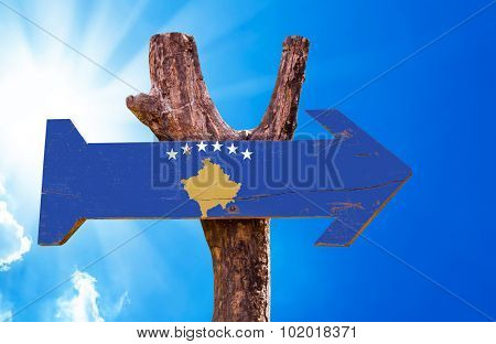Kosovo Flag wooden sign with sky background poster