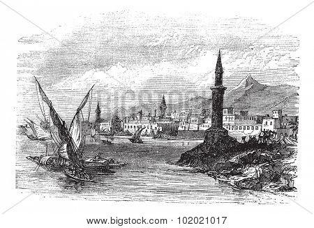 Jeddah or Jiddah or Jidda or Jedda in Saudi Arabia, during the 1890s, vintage engraving. Old engraved illustration of Jeddah with moving boats in front.  Trousset encyclopedia (1886 - 1891).